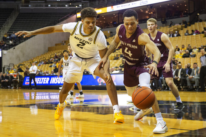 Southern Illinois' Eric McGill, right, and Missouri's Tray Jackson, left, chase a loose ball during the second half of an NCAA college basketball game Sunday, Dec. 15, 2019, in Columbia, Mo. (AP Photo/L.G. Patterson)
