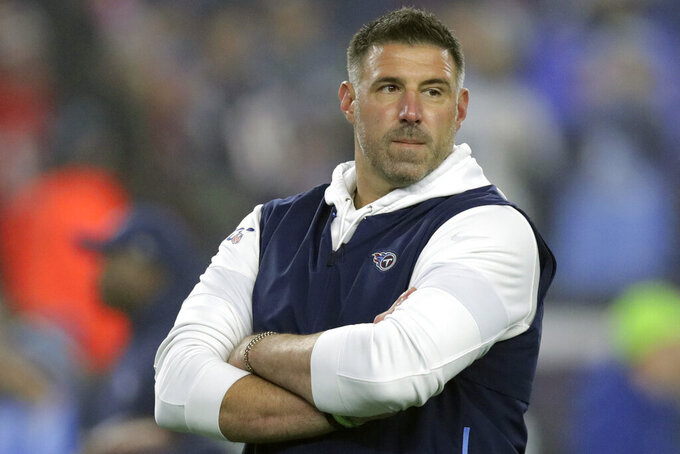 FILE - In this Jan. 4, 2020, file photo, Tennessee Titans head coach Mike Vrabel watches his team warm up before an NFL wild-card playoff football game against the New England Patriots, in Foxborough, Mass. The Titans play the Baltimore Ravens in a divisional playoff game on Saturday, jan. 11, 2020, in Baltimore. (AP Photo/Charles Krupa, File)