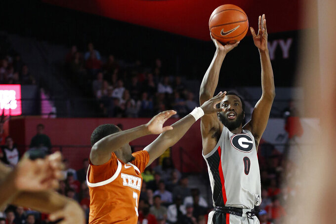 Georgia guard William Jackson II (0) shots a 3-pointer over Texas guard Courtney Ramey (3) during an NCAA college basketball game in Athens, Ga., Saturday, Jan. 26, 2019. (Joshua L. Jones/Athens Banner-Herald via AP)
