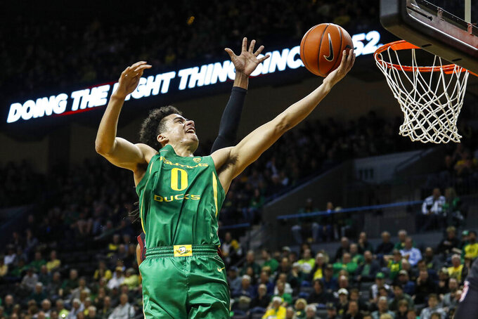 Oregon guard Will Richardson (0) lays in a basket against Stanford during the first half of an NCAA college basketball game in Eugene, Ore., Saturday, March 7, 2020. (AP Photo/Thomas Boyd)