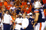 Auburn head coach Gus Malzahn, left, signals to quarterback Bo Nix (10) during the first half of an NCAA college football game against Mississippi State, Saturday, Sept. 28, 2019, in Auburn, Ala. (AP Photo/Butch Dill)