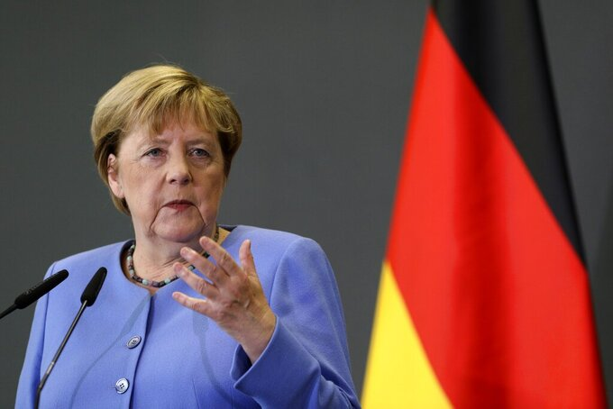 German Chancellor Angela Merkel speaks during a news conference with the Albanian Prime Minister Edi Rama in Tirana, Albania, Tuesday, Sept. 14, 2021. Merkel is on a farewell tour of the Western Balkans, as she announced in 2018 that she wouldn't seek a fifth term as Germany's Chancellor. (AP Photo/Franc Zhurda)