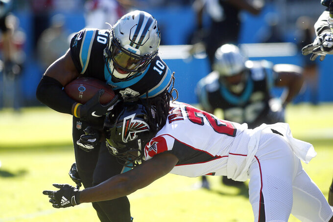 Carolina Panthers wide receiver Curtis Samuel (10) runs while Atlanta Falcons cornerback Desmond Trufant (21) tackles during the first half of an NFL football game in Charlotte, N.C., Sunday, Nov. 17, 2019. (AP Photo/Brian Blanco)