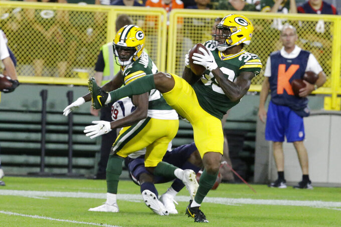 Green Bay Packers defensive back Chandon Sullivan (39) intercepts a Houston Texans pass during the second half of an NFL preseason football game Thursday, Aug. 8, 2019, in Green Bay, Wis. (AP Photo/Mike Roemer)