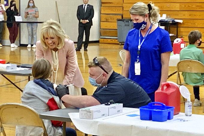 First lady Jill Biden talks to a student who received her coronavirus vaccination Thursday, May 13, 2021, at Capital High School in Charleston, W.Va. (Kenny Kemp/Charleston Gazette-Mail via AP)