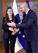 Finnish Prime Minister Sanna Marin, left, is welcomed by European Council President Charles Michel during a bilateral meeting on the sidelines of an EU summit in Brussels, Thursday, Dec. 12, 2019. (Olivier Hoslet, Pool Photo via AP)