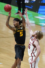 Missouri forward Mitchell Smith (5) passes in front of Oklahoma forward Brady Manek, right, during the second half of a first-round game in the NCAA men's college basketball tournament at Lucas Oil Stadium, Saturday, March 20, 2021, in Indianapolis. (AP Photo/Darron Cummings)