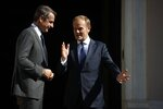 European Council President Donald Tusk, right, speaks with Greece's Prime Minister Kyriakos Mitsotakis during their metering at Maximos Mansion in Athens, Wednesday, Oct. 9, 2019. EU leaders have demanded more