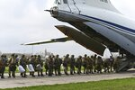Russian paratroopers load into a plane for airborne drills during maneuvers in Taganrog, Russia, Thursday, April 22, 2021. Russia's defense minister on Thursday ordered troops back to their permanent bases following massive drills amid tensions with Ukraine, but said that they should leave their weapons behind in western Russia for another exercise later this year. (AP Photo)