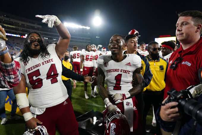 Fresno State offensive lineman Bula Schmidt (54) and wide receiver Keric Wheatfall (1) celebrate a win over UCLA during an NCAA college football game Sunday, Sept. 19, 2021, in Pasadena, Calif. (AP Photo/Marcio Jose Sanchez)