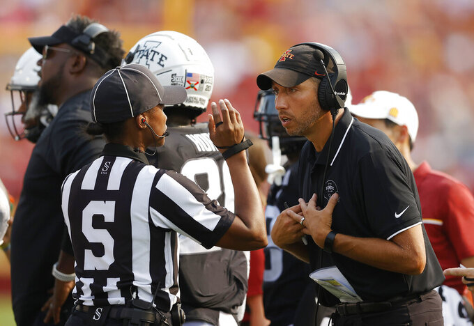 Iowa State head coach Matt Campbell talks with an official on the sidelines during the first half of an NCAA college football game against Iowa, Saturday, Sept. 11, 2021, in Ames, Iowa. (AP Photo/Matthew Putney)