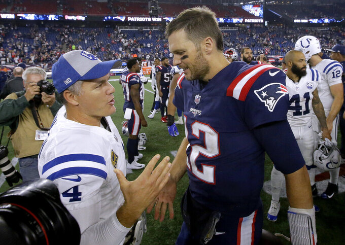 FILE - In this Oct. 4, 2018, file photo, Indianapolis Colts kicker Adam Vinatieri, left, and New England Patriots quarterback Tom Brady speak at midfield after an NFL football game in Foxborough, Mass. The NFL isn't exclusively for the young. From fortysomethings such as Tom Brady and Adam Vinatieri to those nearing a fourth decade from Eli Manning, Philip Rivers and Terrell Suggs, there's still a place for the aged in football. (AP Photo/Steven Senne, File)