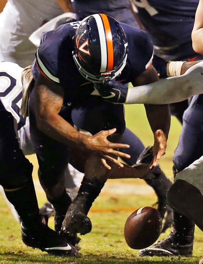 Virginia running back Jordan Ellis fumbles the ball during the first half of the team's NCAA college football game against Pittsburgh in Charlottesville, Va., Friday, Nov. 2, 2018. (AP Photo/Steve Helber)