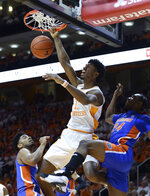 Tennessee forward Kyle Alexander (11) dunks the ball as Florida's Deaundrae Ballard (24) defends during the first half of an NCAA college basketball game, Saturday, Feb. 9, 2019, in Knoxville, Tenn. (Joy Kimbrough/The Daily Times via AP)