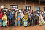FILE - In this Wednesday, May 20, 2020 file photo, Burundians queue to cast their votes in the presidential election, in Giheta, Gitega province, Burundi. The candidate of Burundi's ruling party, Evariste Ndayishimiye, was on Monday, May 25, 2020 declared the winner of the country's presidential election according to the election commission, with main opposition candidate Agathon Rwasa coming second and claiming that the elections were marred by fraud. (AP Photo/Berthier Mugiraneza, File)