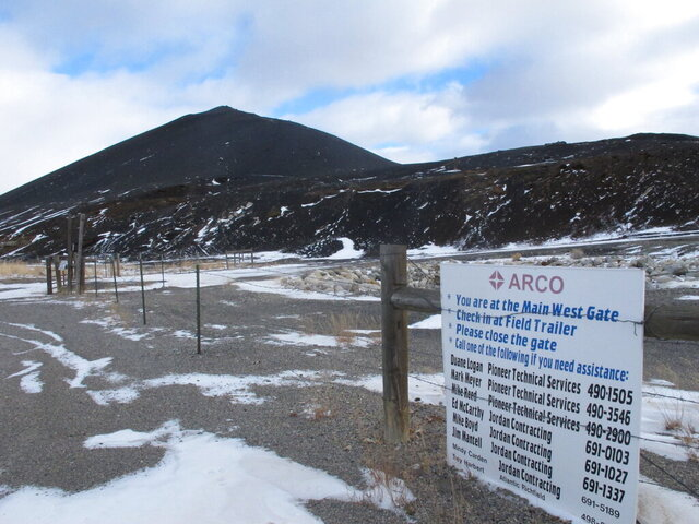"""This Dec. 15, 2016 photo shows a slag pile of mining waste in Anaconda, Mont. Environmental regulators have put a halt to a Montana business association's sale of sandwich bags of mining waste advertised as a """"Bag O'Slag."""" Environmental Protection Agency officials overseeing the Superfund cleanup of pollution from decades of smelter operations in Anaconda came across the potentially toxic tchotchkes for sale by the city's chamber of commerce. The slag contains small amounts of arsenic and lead. Mary Johnston, the chamber's executive director, said Monday, Nov. 18, 2019 the EPA asked them to stop selling the black slag in a re-sealable bag and gave them some alternatives. (AP Photo/Matt Volz)"""