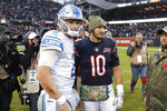 Detroit Lions quarterback Jeff Driskel, left, and Chicago Bears quarterback Mitchell Trubisky (10) talk after an NFL football game in Chicago, Sunday, Nov. 10, 2019. (AP Photo/Charles Rex Arbogast)