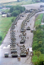 FILE - In this Tuesday, Aug. 20, 1991 file photo, a convoy of Soviet tanks holds its position near Moscow's central airfield less than two miles from the Kremlin, Russia. In Moscow, hundreds of armored vehicles poured into the streets, and long columns of tanks churned up the pavement. Dozens of armored vehicles surrounded the Russian Federation building. (AP Photo/Boris Yurchenko, File)