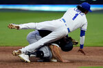 Kansas City Royals second baseman Nicky Lopez falls over Chicago White Sox's Adam Engel after forcing him out at second on a double play hit into by Nick Madrigal during the fifth inning of a baseball game Saturday, Aug. 1, 2020, in Kansas City, Mo. (AP Photo/Charlie Riedel)