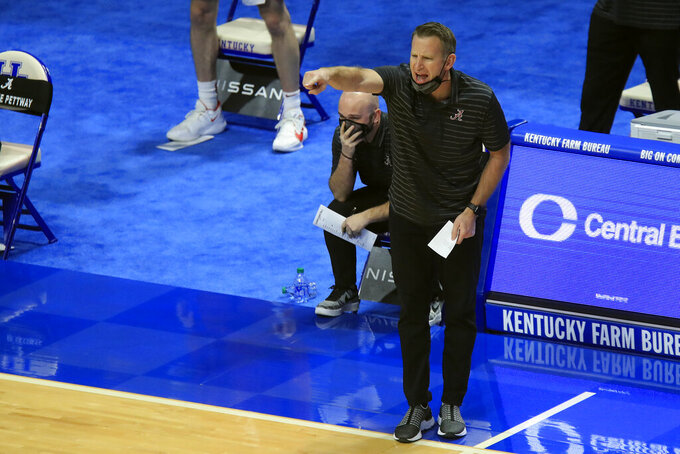 Alabama coach Nate Oats watches the team during the first half of an NCAA college basketball game against Kentucky in Lexington, Ky., Tuesday, Jan. 12, 2021. (AP Photo/James Crisp)