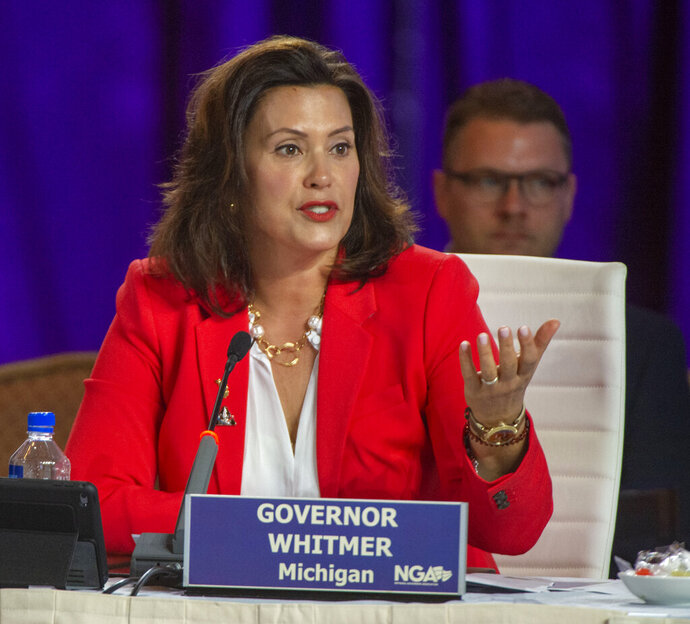 FILE - In this July 26, 2019, file photo, Michigan Gov. Gretchen Whitmer speaks during a session at the National Governor's Association conference in Salt Lake City. Five Democratic governors of states in the Great Lakes region want candidates in next year's presidential election, including President Trump, to back a plan for protecting their freshwater resources. Led by Whitmer, the governors on Monday, July 29, 2019, proposed a six-point platform that seeks increases in federal spending on water treatment infrastructure and environmental cleanups. (Rick Egan/The Salt Lake Tribune via AP, File)
