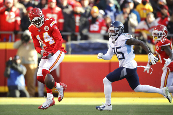 Kansas City Chiefs' Sammy Watkins (14) can't catch a pass during the first half of the NFL AFC Championship football game against the Tennessee Titans Sunday, Jan. 19, 2020, in Kansas City, MO. (AP Photo/Charlie Riedel)
