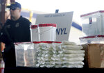 FILE - This Jan. 31, 2019 file photo shows a display of fentanyl and meth that was seized by Customs and Border Protection officers over the weekend at the Nogales Port of Entry at a press conference in Nogales, Ariz. Law enforcement officers in the U.S. Southwest say they have also seen fentanyl-laced pills mimicking Vicodin pain medicine and Xanax anti-anxiety tablets, as well as fentanyl powder to mix with heroin for an extra kick. Officers say that because the tablets are designed to look like prescription medicine, consumers often don't know they are swallowing fentanyl. And because they are made without any kind of quality control, taking them is like Russian roulette because the amount of fentanyl in each can vary widely. (Mamta Popat/Arizona Daily Star via AP, File)
