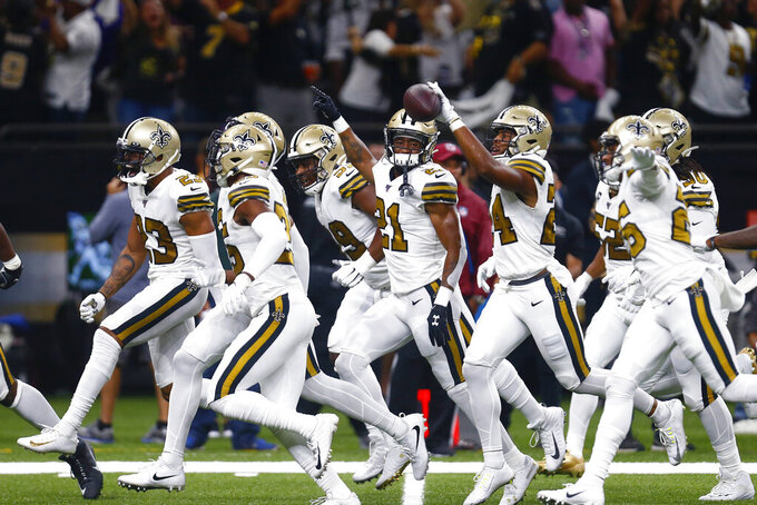 New Orleans Saints strong safety Vonn Bell (24) celebrates his fumble recovery with teammates in the first half of an NFL football game against the Dallas Cowboys in New Orleans, Sunday, Sept. 29, 2019. (AP Photo/Butch Dill)