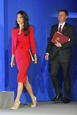 Amal Clooney and Britain's Foreign Secretary Jeremy Hunt during the Global Conference for Media Freedom at The Printworks in London, Wednesday, July 10, 2019. (Dominic Lipinski/PA via AP)