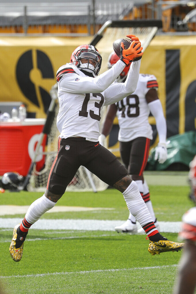 Cleveland Browns wide receiver Odell Beckham Jr. (13) catches a pass during warm-ups prior to an NFL game against the Pittsburgh Steelers, Sunday, Oct. 18, 2020, in Pittsburgh. The Steelers defeated the Browns 38-7. (Margaret Bowles via AP)