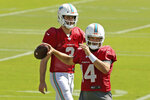 Miami Dolphins quarterbacks Ryan Fitzpatrick (14) and Josh Rosen (3) running drills during practice at the Baptist Health Training Facility at Nova Southeastern University on Wednesday, October 16, 2018, in Davie in preparation for their game against the Buffalo Bills on Sunday at New Era Field in New York. (David Santiago/Miami Herald via AP)