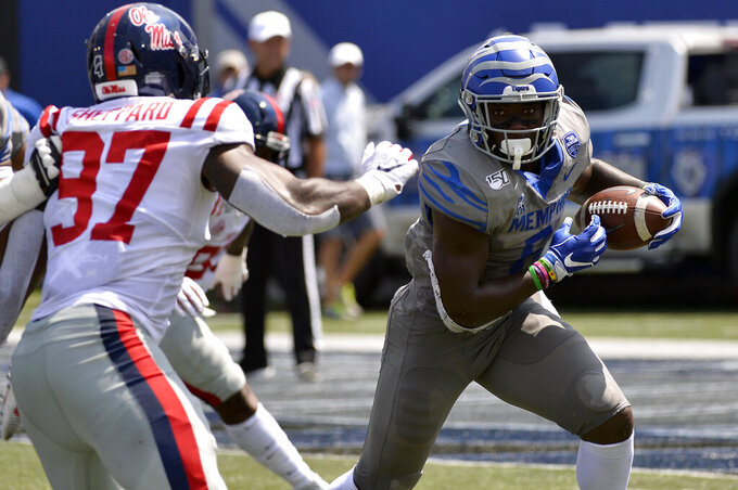 Memphis running back Patrick Taylor Jr. (6) carries the ball against Mississippi linebacker Qaadir Sheppard (97) in the first half of an NCAA college football game Saturday, Aug. 31, 2019, in Memphis, Tenn. (AP Photo/Brandon Dill)
