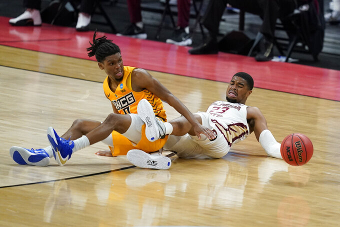 UNC-Greensboro's Keyshaun Langley (0) and Florida State's M.J. Walker (23) battle for a loose ball during the second half of a first-round game in the NCAA men's college basketball tournament at Banker's Life Fieldhouse, Saturday, March 20, 2021, in Indianapolis. (AP Photo/Darron Cummings)