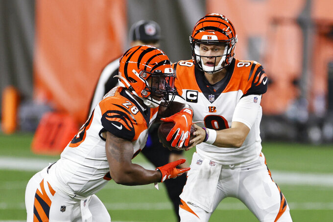 Cincinnati Bengals quarterback Joe Burrow, right, hands the ball off to running back Joe Mixon during the first half of the team's NFL football game against the Cleveland Browns, Thursday, Sept. 17, 2020, in Cleveland. (AP Photo/Ron Schwane)