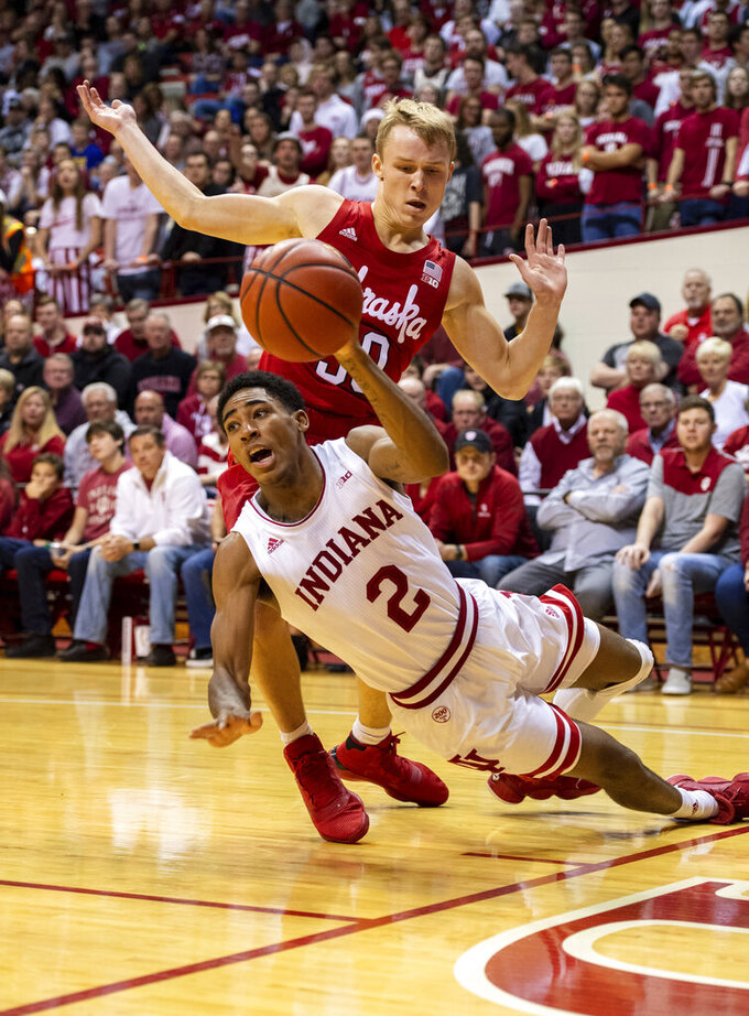 Indiana guard Armaan Franklin (2) tries to get a pass off to a teammate as he is defended by Nebraska guard Charlie Easley (30) along the baseline during the first half of an NCAA college basketball game, Friday, Dec. 13, 2019, in Bloomington, Ind. (AP Photo/Doug McSchooler)