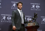 Oklahoma quarterback Kyler Murraym who won the Heisman Trophy, poses with the award Saturday, Dec. 8, 2018, in New York. (AP Photo/Craig Ruttle)