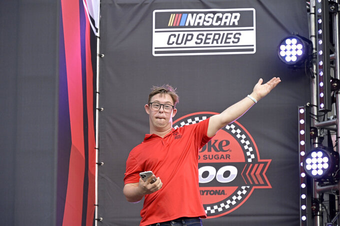 Special Olympics Florida athlete Chris Nikic encourages the crowd before a NASCAR Cup Series auto race at Daytona International Speedway, Saturday, Aug. 28, 2021, in Daytona Beach, Fla. (AP Photo/Phelan M. Ebenhack)