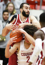 Washington State forward CJ Elleby (2) and Stanford center Josh Sharma go after a rebound during the second half of an NCAA college basketball game in Pullman, Wash., Saturday, Jan. 19, 2019. Stanford won 78-66. (AP Photo/Young Kwak)