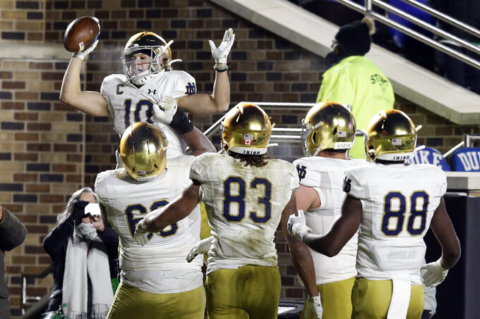 Notre Dame wide receiver Chris Finke (10) is congratulated by teammates following Finke's touchdown against Duke during the second half of an NCAA college football game in Durham, N.C., Saturday, Nov. 9, 2019. (AP Photo/Gerry Broome)