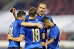 Italy's Nicola Barella, center, celebrates with his teammates after scoring his side's second goal during the international friendly soccer match between Italy and Czech Republic in Bologna, Italy, Friday, June 4, 2021. (AP Photo/Antonio Calanni)