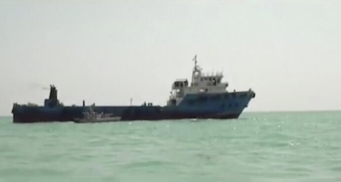 This undated image made from a video provided by the IRGC/IRIB shows a ship in the Persian Gulf. Iranian forces seized the ship, which it suspected of carrying smuggled fuel, state media reported Sunday, Aug. 4, 2019, marking the Revolutionary Guard's third seizure of a vessel in recent weeks and the latest show of strength by the paramilitary force amid a spike in regional tensions. (IRGC/IRIB via AP)