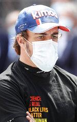 Alpine driver Fernando Alonso of Spain prior to the start of the Monaco Grand Prix at the Monaco racetrack, in Monaco, Sunday, May 23, 2021. (Sebastien Nogier, Pool via AP)
