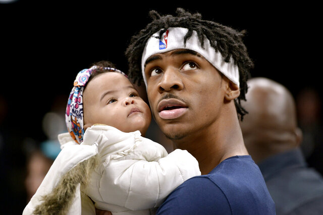 Memphis Grizzlies guard Ja Morant holds his daughter, Kaari Jaidyn Morant, before the team's NBA basketball game against the Portland Trail Blazers on Wednesday, Feb. 12, 2020, in Memphis, Tenn. (AP Photo/Brandon Dill)