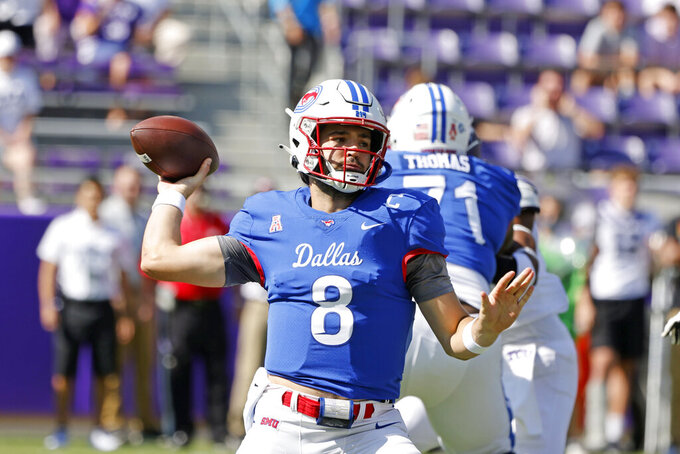 SMU quarterback Tanner Mordecai (8) throws a pass against TCU during the first half of an NCAA football game in Fort Worth, Texas, Saturday, Sept. 25, 2021. (AP Photo/Michael Ainsworth)