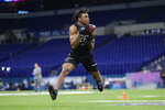 FILE - In this Feb. 27, 2020, file photo, LSU wide receiver Justin Jefferson runs a drill at the NFL football scouting combine in Indianapolis. Jefferson was selected by the Minnesota Vikings in the first round of the NFL draft. (AP Photo/Michael Conroy, File)