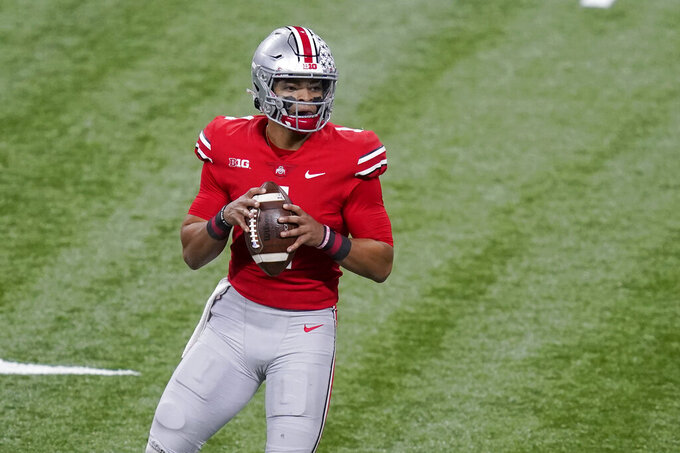 Ohio State quarterback Justin Fields drops back to pass during the first half of the Big Ten championship NCAA college football game against Northwestern, Saturday, Dec. 19, 2020, in Indianapolis. (AP Photo/Darron Cummings)