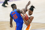 Florida's Osayi Osifo (15) and Tennessee's Yves Pons (35) get tangled in the first half of an NCAA college basketball game in the Southeastern Conference Tournament Friday, March 12, 2021, in Nashville, Tenn. (AP Photo/Mark Humphrey)