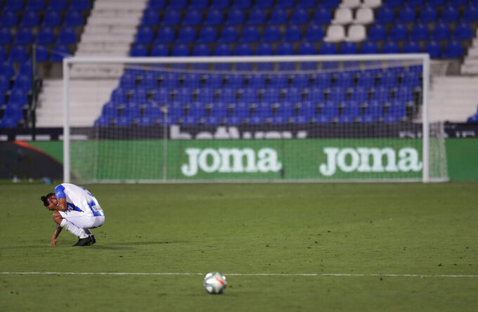 Leganes' Jonathan Silva, reacts after the Spanish La Liga soccer match between Leganes and Real Madrid at the Butarque Stadium in Leganes, on the outskirts of Madrid, Spain, Sunday, July 19, 2020. The match ended 2-2 draw, and Leganes are being relegated from La Liga to the second division. (AP Photo/Bernat Armangue)