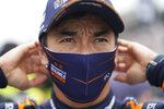 Takuma Sato, of Japan, looks at the speed chart during qualifications for the Indianapolis 500 auto race at Indianapolis Motor Speedway, Saturday, May 22, 2021, in Indianapolis. (AP Photo/Darron Cummings)