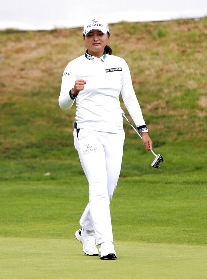 Jin Young Ko, of South Korea, reacts after making the winning putt on the 18th hole during the final round of the LPGA Cambia Portland Classic golf tournament in West Linn, Ore., Sunday, Sept. 19, 2021. (AP Photo/Steve Dipaola)
